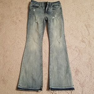 Destroyed high-rise denim jeans